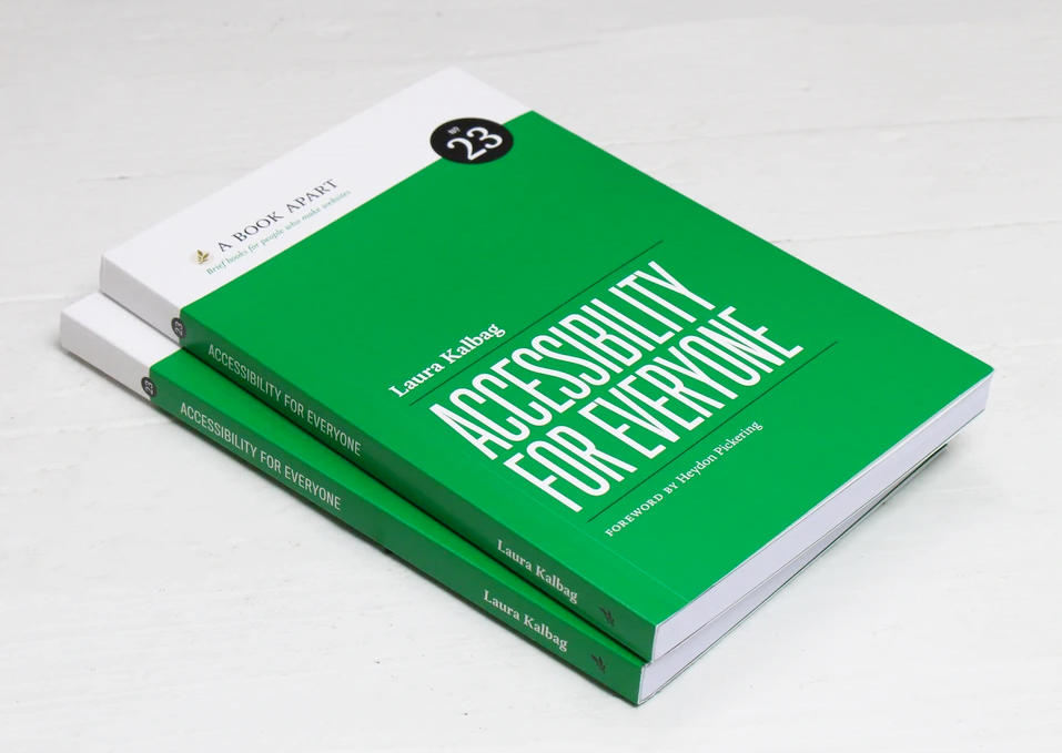 Two stacked copies of the book, Accessibility for Everyone.